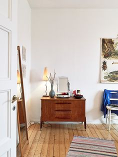{White walls and wooden floors.}