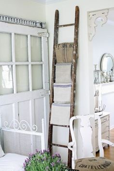 love the ladder as a blanket/towel rack idea