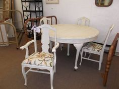 $225 - This lovely round 5 leg table has been painted creamy white, distressed, and finished with a dark wax. It includes 4 chairs that are painted to match with newly upholstered seats! Too cute!  ***** In Booth H9 at Main Street Antique Mall 7260 E Main St (east of Power RD on MAIN STREET) Mesa Az 85207 **** Open 7 days a week 10:00AM-5:30PM **** Call for more information 480 924 1122 **** We Accept cash, debit, VISA, MasterCard or Discover.