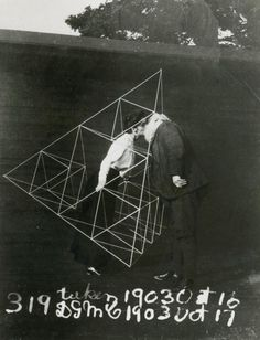 Alexander Graham Bell and Mabel kissing within a tetrahedral kite, 1903