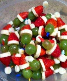 Make Grinch Kabobs!!!!! Layer the following items on a toothpick: - 1 mini marshmallow  - 1 strawberry with the top cut off - 1 thin slice of banana  - 1 white grape (also known as a green grape LOL)  There's an alternative to using the banana slice by using a slice of string cheese instead.