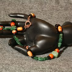 Wood, czech glass and emerald green aventurine. Claimed by Y.
