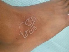 I think a white ink tattoo would be cute