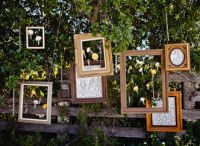 hanging pictures, empty frames, wedding decorations, rustic weddings, vintage frames, photo booths, picture frames, hanging frames, outdoor weddings