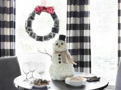 Create a fun #holiday tablescape with this lush snowman made from white carnations and creative embellishments.  #HolidayHouse