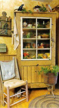 Old Mustard Cupboard...love the window pane door & prim needfuls.