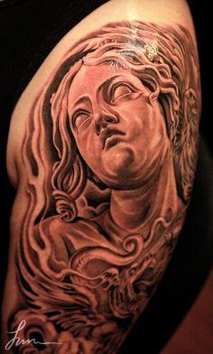 Jun Cha Greek marble statue tattoo.