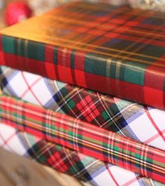 Books decorated with tartan papers via mod podge at Romancing the Home ~~ holiday, christmas elf, tartan wrap, tartan plaid, wrap paper, plaid wrap, christmas gifts, book cover, old books