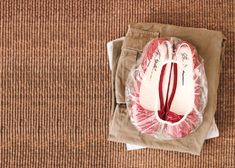 Grab the shower cap from your hotel and use it to wrap your shoes & keep your clothes clean - genius!