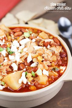 Yummy crock pot chicken chili stew with pinto beans, potatoes, corn, spices and topped with feta cheese. Easy prep and so delicious!
