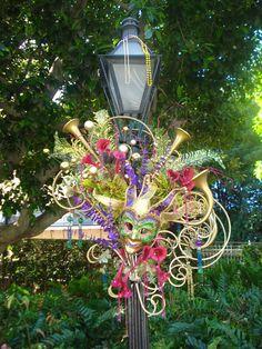 Mardi Gras decorations on street lamp post