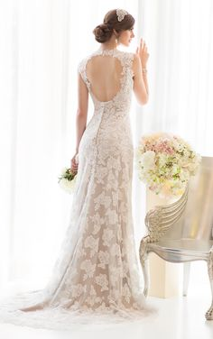 intage wedding dresses line comes this romantic Lace over Lustre Satin gown. Designer details include a V neck, waist sash, court train, keyhole back and zipper closure under fabric covered buttons.