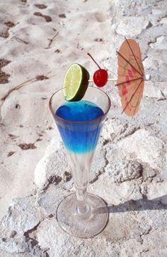 Blue Lagoon, with vodka, Blue Curacao liqueur, lemonade and cherry.