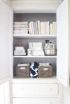 Organized linen closet.  Great idea to move bathroom cleaning products to the linen closet!  Convenient for quick clean ups.