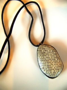 rock necklaces covered with book page craft idea