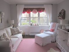 Love the pompoms hanging from the window in this sweet pink and gray nursery!
