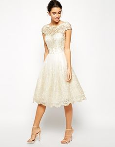 Seems like this would make a perfectly adorable wedding dress Chi Chi London Lace Prom Dress with Sweetheart Neck
