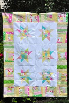 As if I needed another baby quilt to aspire toward stitching! I love the wonky block border!!!