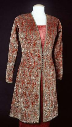 This three-quarter length orange-red cut velvet jacket was printed with metallic paints with Venetian glass buttons and silk loop closure at the center front.