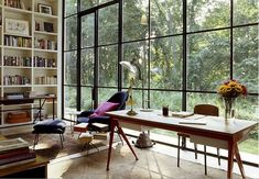 My dream work space: wall of windows, floor to ceiling bookcase. By Michael Haverland
