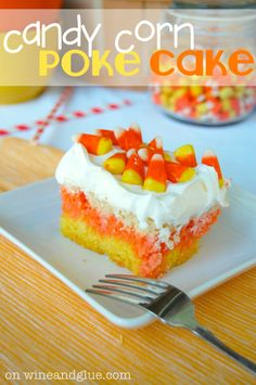 Candy Corn Poke Cake!  | www.wineandglue.com | The perfect Halloween dessert that is super easy to make but has a big wow factor!! #candycorn