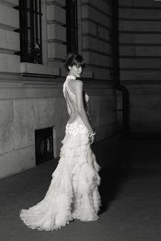 Ultra low back wedding dress by Cymbeline.