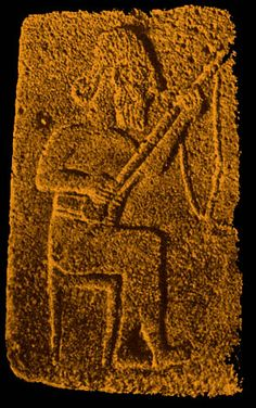 ":   The next stringed instrument with fingerboard is from two Hittite sculptures (circa 1500 BC). The first was found at Sendschirli in North Syria by German archeologists. When Sendschirli was at its peak it was a ""Royal"" Residence. The stringed instrument has a strap and rests on the players knee. The ""bearded"" player is shown with eyes fixed on the playing fingers of the left hand.  The Gate Relief from Sendschirli - now in the Vorasiatische Museum - Berlin"