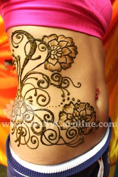side tattoo on ribs with vines and flowers