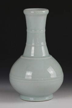 "Lungquan glazed vase with flaring rim and footed base (China, ca,18/19th C), ribbing along neck and body (h: 9.75 x w: 6"")."