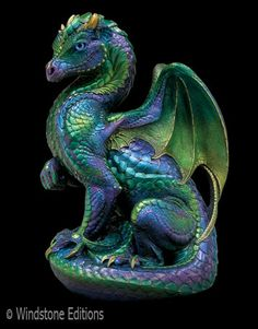 Dragon sculpture by Melody Pena, produced by Windstone Editions.    Love this beautiful peacock dragon!