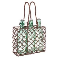 "Three glass swing-top bottles with woven wicker tote.    Product: 3 Bottles and toteConstruction Material: Glass and wickerColor: Green and brownFeatures: Will enhance any décorDimensions:  9.8""H x 11.6"" W x 3.9 D (overall) Cleaning and Care: Hand wash bottles. Wipe holder with dry cloth."