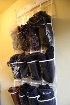 A cool organizing solution for mittens and gloves - put them into a clear shoe organizer and hang on the inside of a closet door