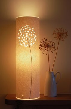 Lights + paper = my favorite!    Parchment Paper Lamps. From http://www.apartmenttherapy.com/sf/bedroom/hannah-nunn-papercut-lamps-075190. Available at Etsy.