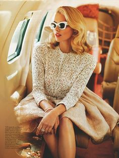 Jet set in style in these vintage cat eye sunglasses and a delicate lace blouse.