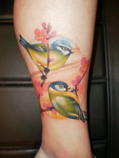 Feminine bird tattoo
