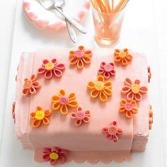 With maraschino cherry-flavor cake, Cherry-Almond Butter Frosting, and beautiful decorations made of candy clay, this pink cake is a true Easter masterpiece: http://www.bhg.com/holidays/easter/recipes/fun-to-make-easter-treats/?socsrc=bhgpin041414cherryflowerpowercake&page=22