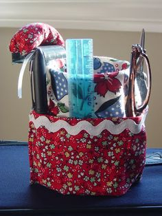 """Car Caddy Tutorial from Sew Many Ways - it's built around the kind of cup-holder that hangs from your window, but you could riff on it to fit other spots in the car. """"I always take hand sewing with me and this is a great little holder for all my sewing needs."""". It's a general recipe to apply to your car and your needs. Notice that it's a safe place for your glasses, if you take them off for close work (or the occasional nap!)"""