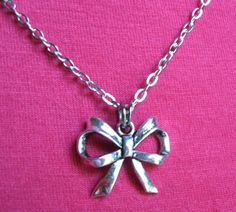 SILVER BOW NECKLACE. $17.00.  Tie yourself up in a bow!  :)