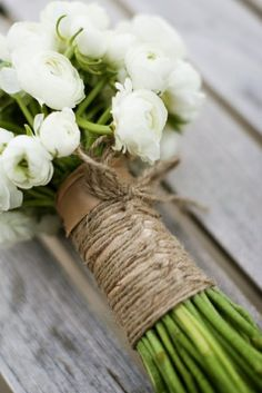 gorgeous. white ranunculus, i think, wrapped in twine.