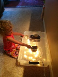 Add fairy lights to a plastic storage box to make a light box, genius.