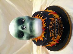 Ghost rider inspired birthday cake for a 60 year old Harley Davidson rider  www.thecakedoctor.vpweb.co.uk