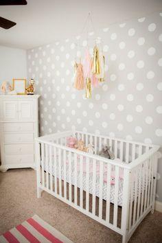 gray polka dot accent wall nursery