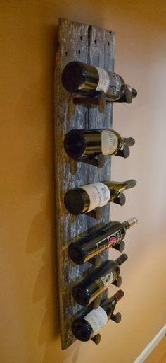 Barn wood & railroad spike wine rack. Good thing Manuel works for the railroad!!