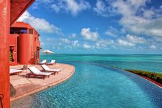 The views stretch on and on from the waters of the moat-like infinity pool.