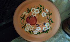 Fruit plate on a terra cotta saucer.