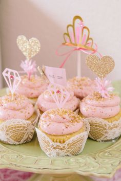 OH LAND!!! LOVE these - gold sparkle on the top of pink frosting, lace covers for the cupcakes and sparkly heart toppers with fluffy pink stuff at the base -
