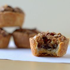 Pecan Tassies For the Dough: 1 cup unsalted butter 6 ounces cream cheese 2 cups all-purpose flour  For the Filling: 1½ cups light brown sugar 1 cup chopped pecans, plus more for sprinkling on top 2 eggs 2 tablespoons unsalted butter, melted ½ teaspoon vanilla extract