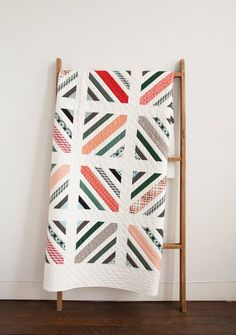 Denyse Schmidt quilt. I have the perfect fabric for this quilt (the mama said sew jelly roll)