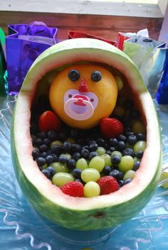 Baby shower center piece/ fruit salad idea.  Carved out a watermelon and filled with fruit.  I used a grapefruit for the head.
