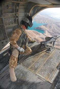 #TheAfghanistanYouNeverSee: Crewman Pete Galvin looks out over Kajaki lake from the ramp of an #RAF Chinook http://t.co/YPEtdomN